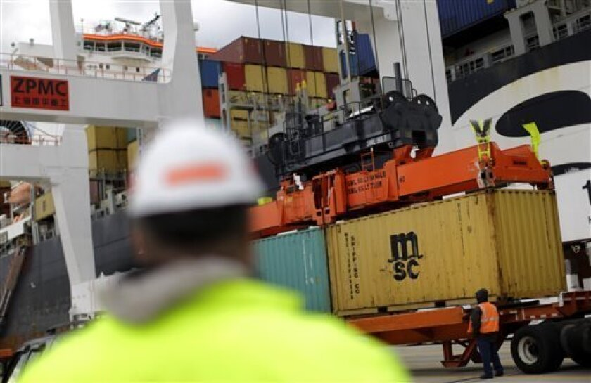 FILE - In this March 1, 2013 photo, containers are placed on a trailer by a crane after being removed from a ship at the Port of Baltimore's Seagirt Marine Terminal in Baltimore. The government reports on worker productivity and labor costs in the January-March quarter on Thursday, May 2, 2013. (AP Photo/Patrick Semansky, File)