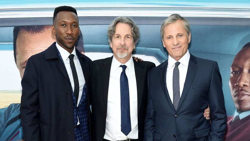 """Mahershala Ali, left, writer-director Peter Farrelly and Viggo Mortensen at the """"Green Book"""" New York premiere. The film was nominated for best director, best screenplay and best picture Golden Globes."""