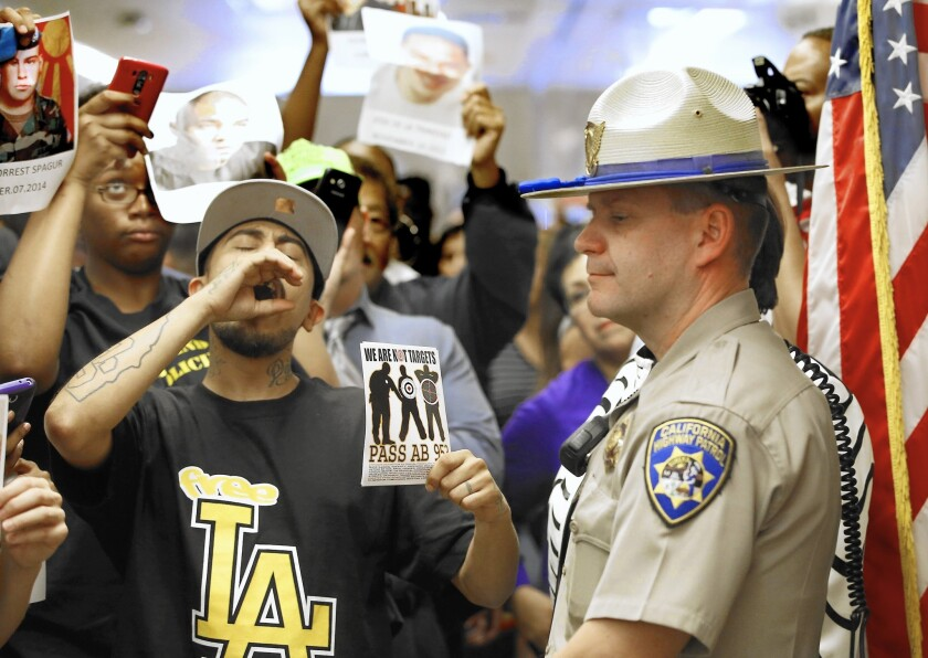 la-apphoto-police-protests-legislature-jpg-20151004
