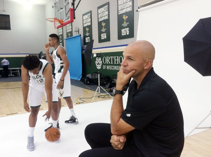 Milwaukee Bucks' Jabari Parker and Giannis Antetokounmpo get their picture taken while head coach Jason Kidd waits during the team's NBA basketball media day Monday, Sept. 28, 2015, in St. Francis, Wis. (AP Photo/Morry Gash)