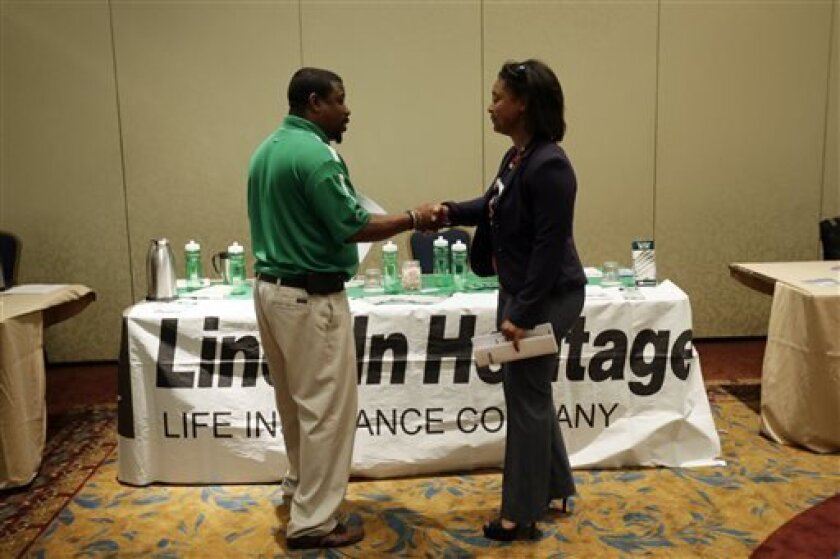 In this Monday, June 24, 2013, photo, job seeker Shawanda Strother, right, shakes hands with recruiter George McGlone III after a meeting at a career fair, in King of Prussia, Pa. The government reports on job openings and labor turnover for June on Tuesday, Aug. 6, 2013. (AP Photo/Matt Slocum)