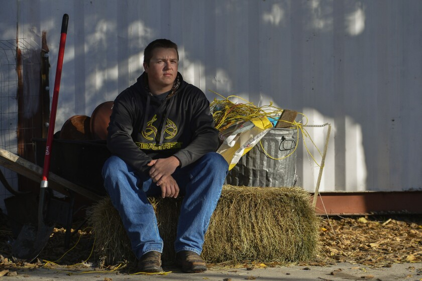 Jake Winkler, a 12th grader at Roots Charter High School, poses for a portrait at the school's farm