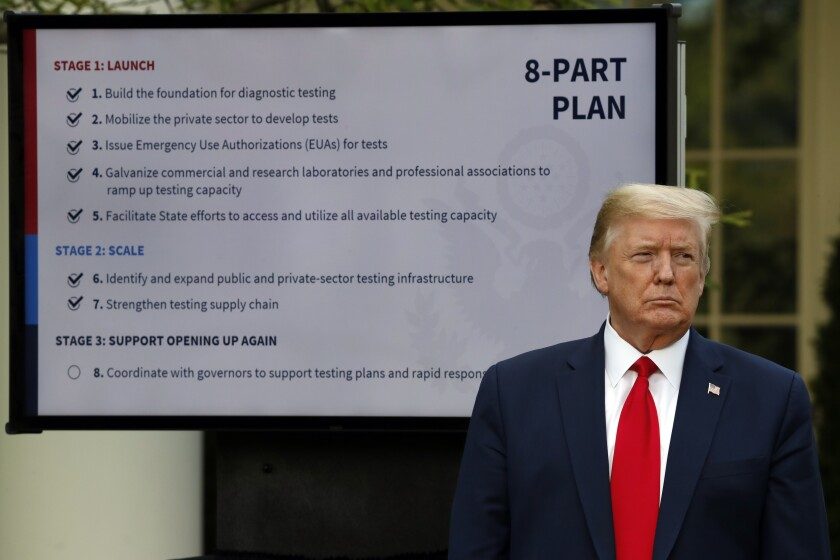 FILE - In this April 27, 2020, file photo, President Donald Trump listens during briefing about the coronavirus in the Rose Garden of the White House in Washington. For weeks, Trump has been eager to publicly turn the page on the coronavirus pandemic. But now the White House fears that the very thing that finally shoved the virus off centerstage — mass protests over the death of George Floyd — may bring about its resurgence. (AP Photo/Alex Brandon, File)