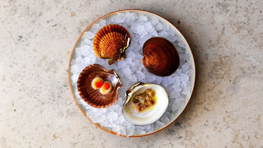 The 100 year old mahogany clam: It is served with salted green gooseberries, pickled blackcurrant sh