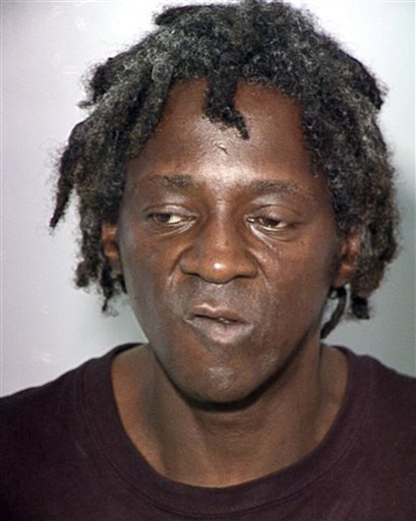 FILE - This Oct. 17, 2012, file photo, provided by the Las Vegas Police Department shows rapper Flavor Flav, whose name is William Jonathan Drayton Jr., in a police booking photo in Las Vegas. A judge in Las Vegas is expected to hear evidence in a felony case Wednesday, April 10, 2013, alleging ent