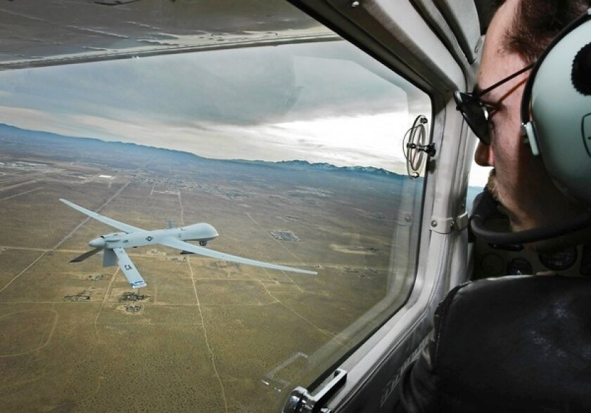 Pilot Mark Bernhardt watches a Predator drone from a chase plane as it flies over Victorville. General Atomics Aeronautical Systems Inc. of Poway plans to sell an undisclosed number of unarmed Predators to the United Arab Emirates for $197 million.