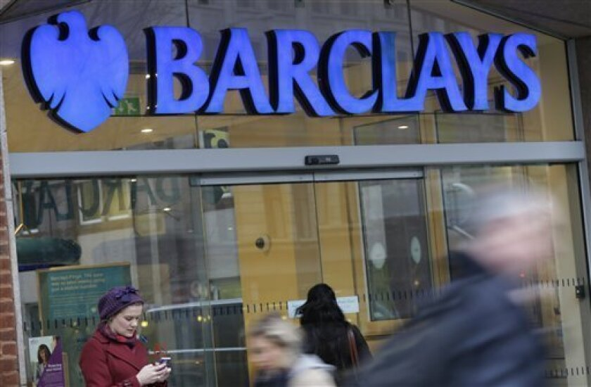 Customers wait outside a retail branch of Barclays Bank for the bank to open in London, Tuesday, Feb. 12, 2013. Barclays PLC has announced plans to cut at least 3,700 jobs in a major restructuring that follows a scandal-hit year for the U.K. bank. The bank said Tuesday it will cut at least 1,800 po
