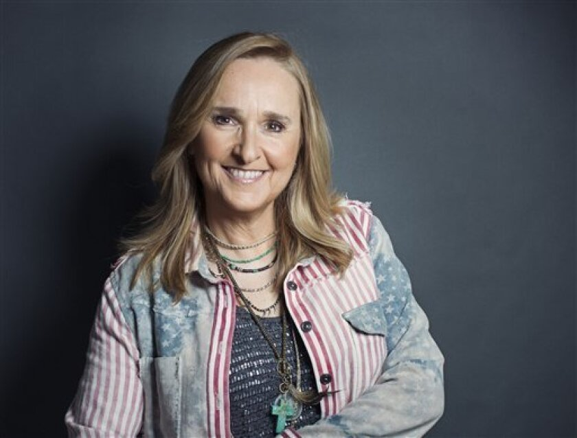 "This Sept. 4, 2012 photo shows American singer-songwriter Melissa Etheridge in New York. The Grammy Award-winning singer-songwriter, whose 12th studio album has been released on Tuesday, challenged herself to play all the guitar parts this time around for the first time.  ""I kind of thought when I"