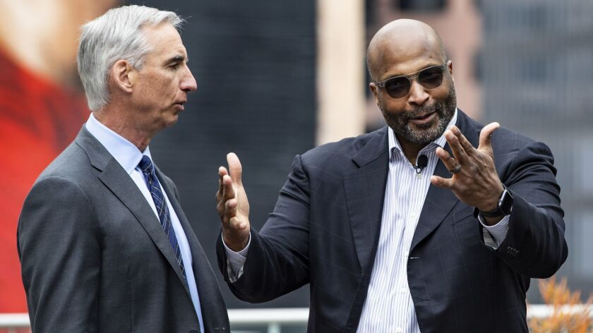 LOS ANGELES, CA - MAY 7, 2019: XFL Commissioner and CEO Oliver Luck, left, announces that Winston M