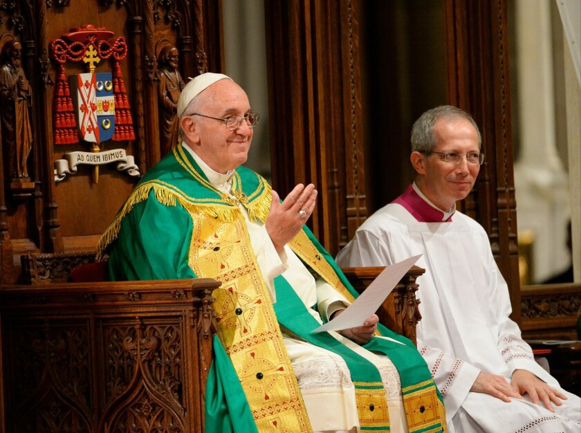 Pope Francis, left, leads an evening prayer service at St. Patrick's Cathedral, Thursday, Sept. 24, 2015, in New York. (Robert Deutsch/USA Today via AP, Pool)
