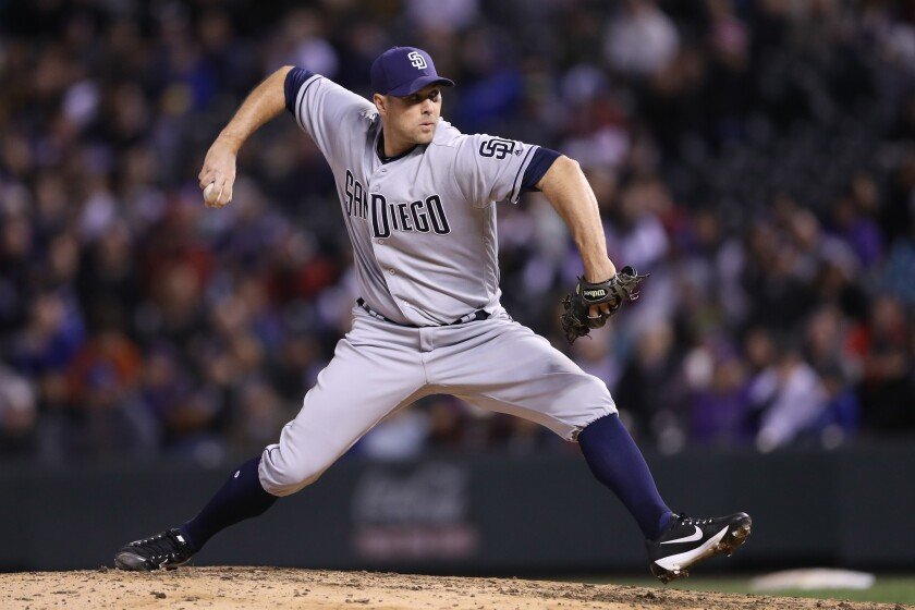 Padres reliever Craig Stammen pitches against the Rockies last season at Coors Field.