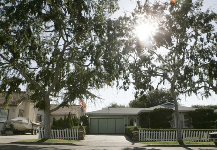 Homes along Midway City's Wilson Street, which claims award-winning actress Michelle Pfeiffer as its most famous former resident. Wide streets and large lots give the town a Midwestern flavor.
