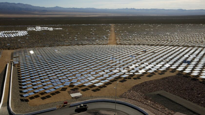 IVANPAH VALLEY ,CA., FEBRUARY 13, 2014: Some of the 347,000 garage door-sized mirrors at the Ivanpah