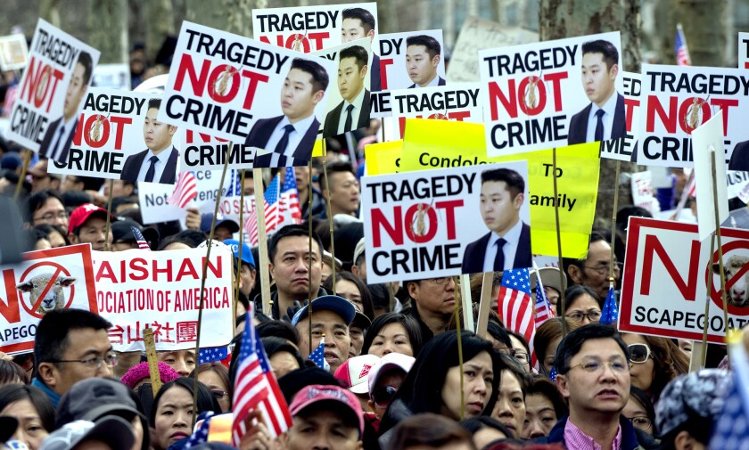Protesters rally in Brooklyn on Saturday in support of former NYPD Officer Peter Liang, who was convicted of manslaughter for the shooting death of Akai Gurley.
