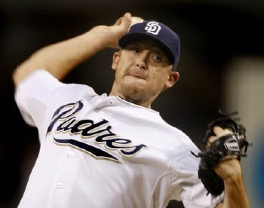 San Diego Padres starting pitcher Kevin Correia works against the San Francisco Giants in the first inning of a baseball game  Friday, Oct. 2, 2009 in San Diego. (AP Photo/Lenny Ignelzi)
