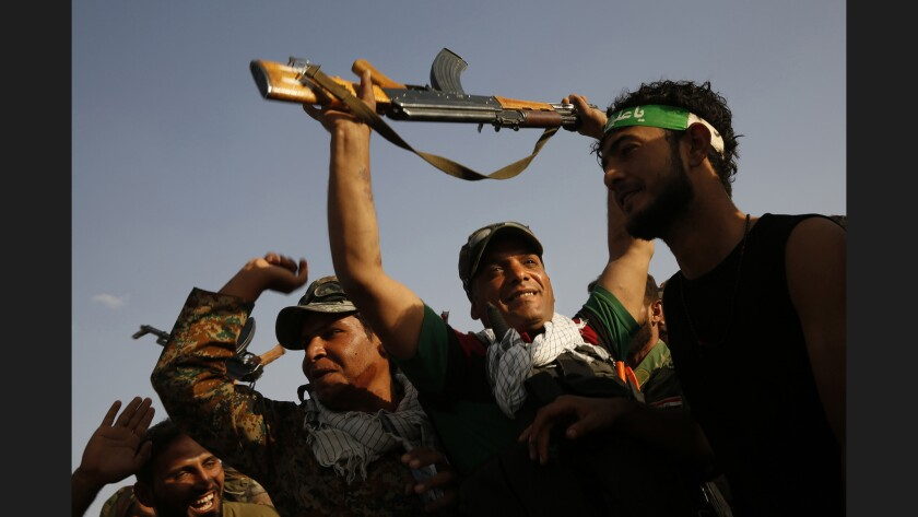 Militiamen chant before going into battle alongside Iraqi army forces as they fight against Islamic State near Mosul.