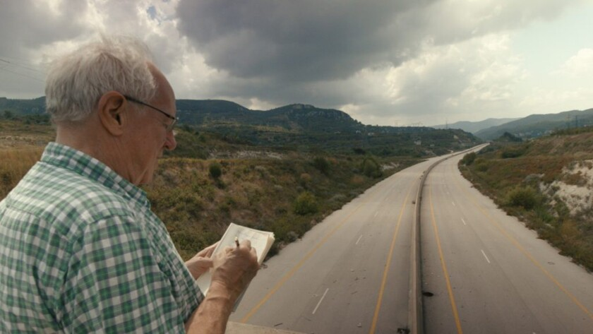 "British journalist Robert Fisk, notepad in hand, in the documentary ""This Is Not a Movie."""