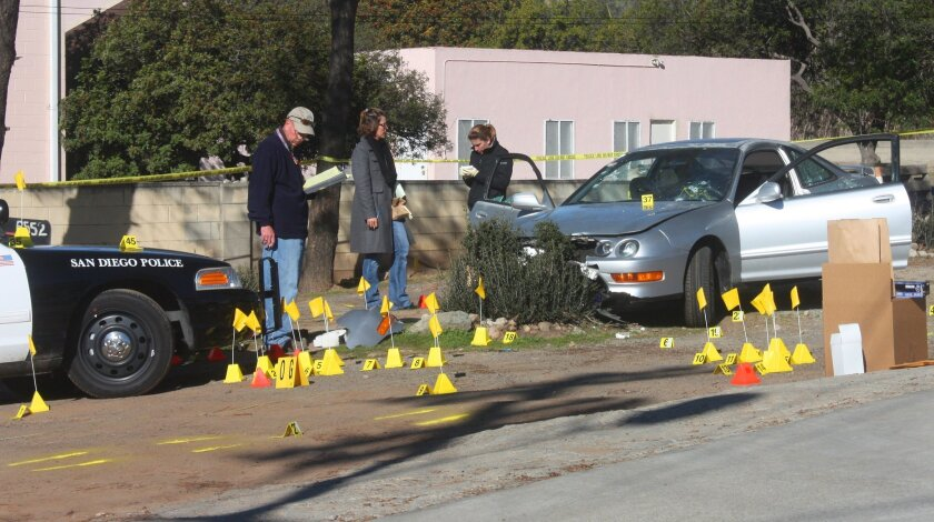 San Diego Police Department homicide detectives investigate an officer-involved fatal shooting that took place after a police chase in the Encanto neighborhood on Jan. 12, 2013.