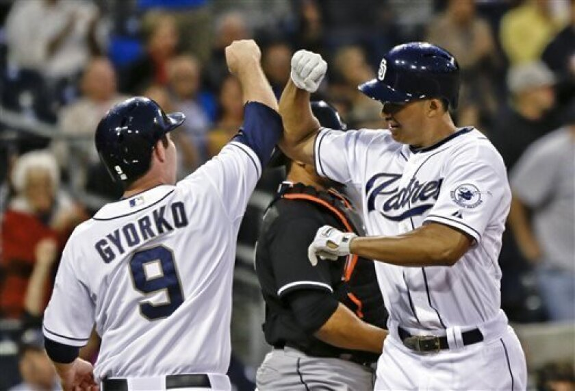 San Diego Padres' Will Venable is congratulated by Jedd Gyorko after his two-run home run against the Miami Marlins in the second inning of a baseball game in San Diego, Tuesday, May 7, 2013. (AP photo/Lenny Ignelzi)