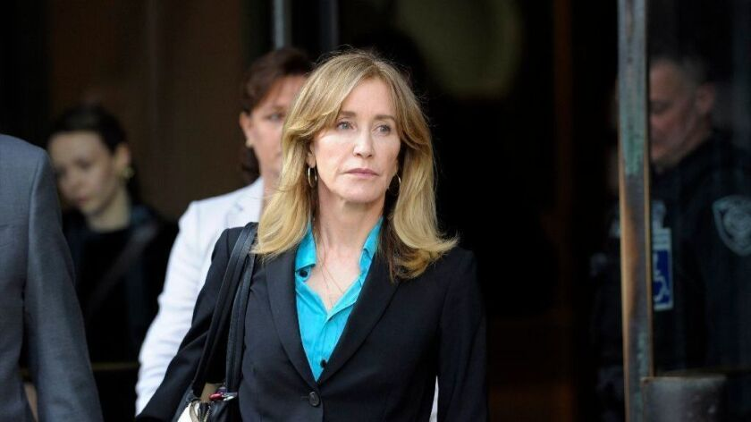 Felicity Huffman outside federal court in April 2019