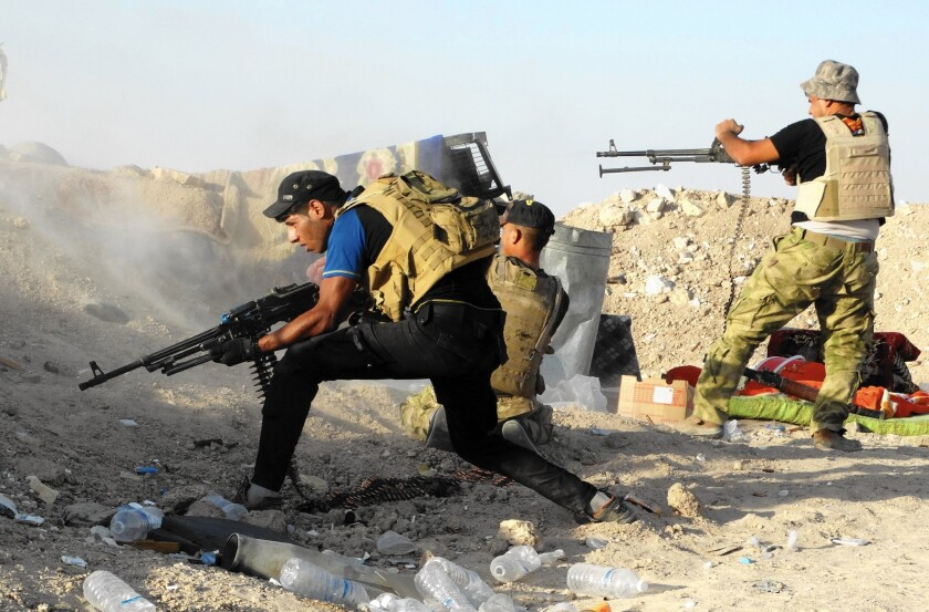 Iraqi security forces defend their positions against an Islamic State attack in Husaybah, 5 miles east of Ramadi, Iraq, on June 15, 2015.