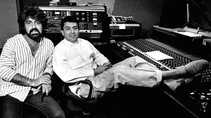 Shuki Levy, left, and Haim Saban, partners in Saban Productions, take a break in their Studio City sound studio in 1986.