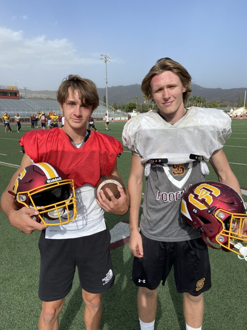 Simi Valley quarterback Steele Pizzella, left, and senior linebacker Will Bush pose for a photo.