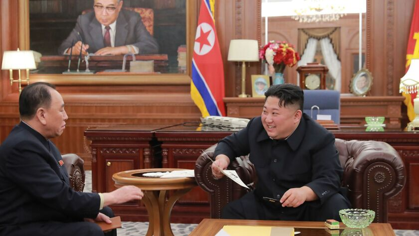 North Korean leader Kim Jong Un, right, speaks Jan. 23 with Kim Yong Chol, his lead negotiator in talks with the United States, in an undisclosed location in North Korea.