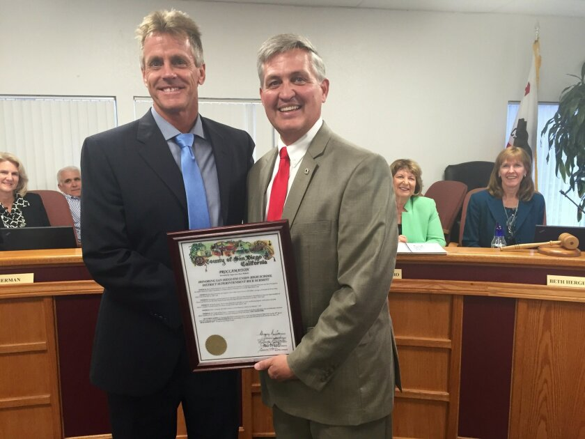 Outgoing SDUHSD Superintendent Rick Schmitt with Superintendent Dave Roberts.