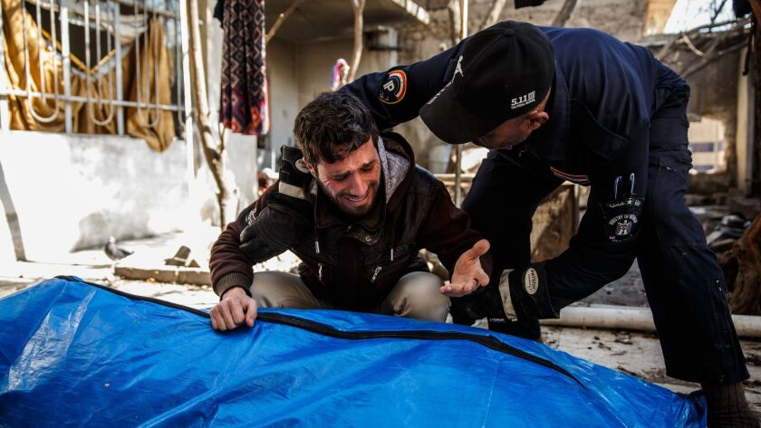 MOSUL, NINEVEH PROVINCE -- FRIDAY, MARCH 24, 2017: A man grieves for his loved ones found dead in th