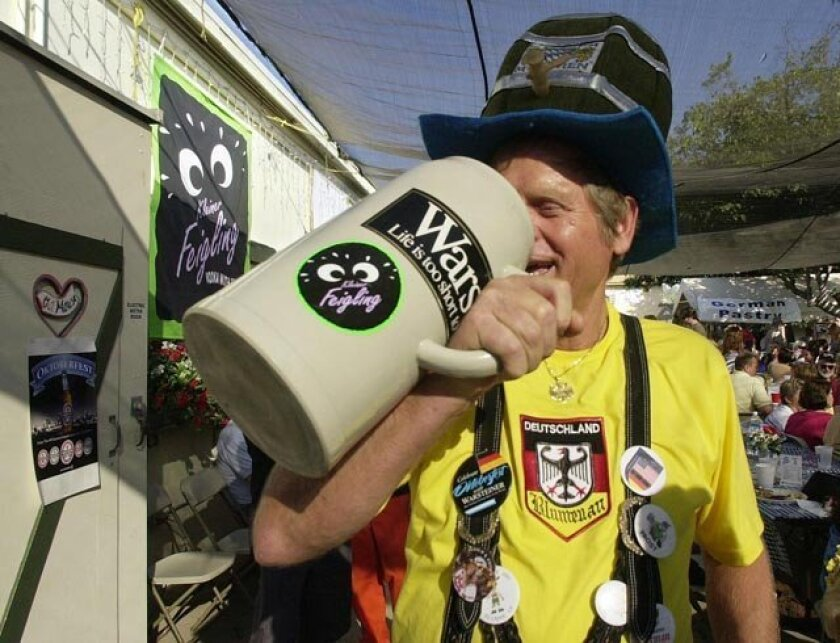Hans Nenn, of La Jolla, drinks beer from his 5 liter mug at Oktoberfest in El Cajon.