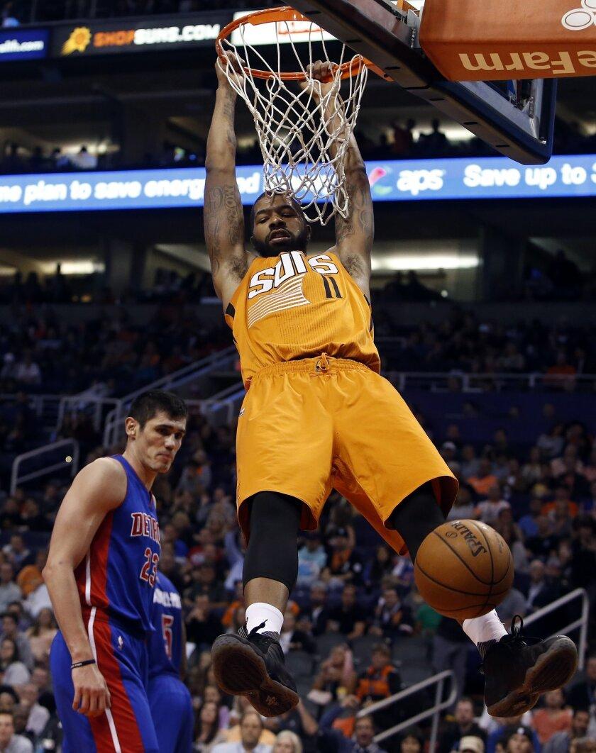 FILE - In this Nov. 6, 2015, file photo, Phoenix Suns forward Markieff Morris (11) dunks the ball against the Detroit Pistons in the third quarter during an NBA basketball game, in Phoenix. (AP Photo/Rick Scuteri), File