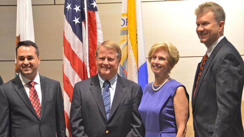 Newly elected Newport Beach city council members pose for photo with Judge Rogan, from left, Kevin M
