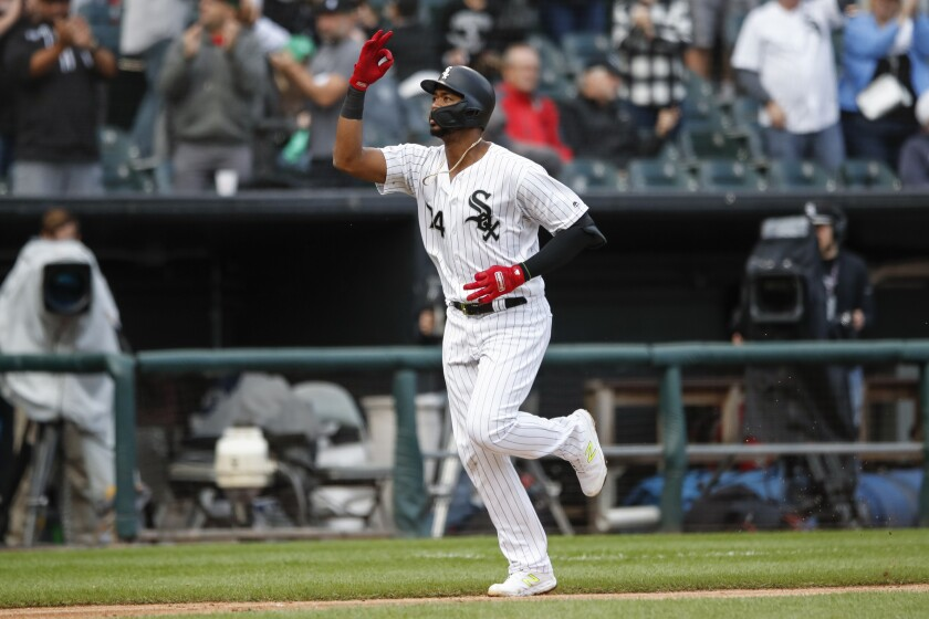 Chicago White Sox's Eloy Jimenez celebrates as he rounds the bases after hitting a solo home run off of Detroit Tigers' Edwin Jackson during the seventh inning of Game 1 of a baseball doubleheader, Saturday, Sept. 28, 2019, in Chicago. (AP Photo/Kamil Krzaczynski)