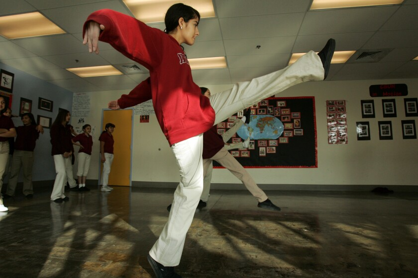 A student kicks up her heels in dance class at Aspire Public Schools in Huntington Park.