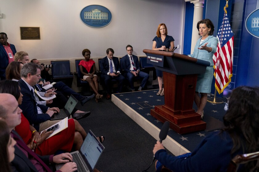 Commerce Secretary Gina Raimondo, accompanied by White House press secretary Jen Psaki, second from right, speaks during a press briefing in the briefing room of the White House in Washington, Thursday, July 22, 2021. (AP Photo/Andrew Harnik)