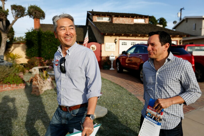 Al Muratsuchi, left, a Democrat running for state Assembly in a crucial South Bay swing district, and Assembly Speaker Anthony Rendon canvass a neighborhood in Torrance.