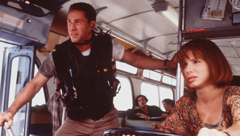 """Keanu Reeves and Sandra Bullock in the 1994 bus thriller """"Speed,"""" a summer movie that still holds up."""