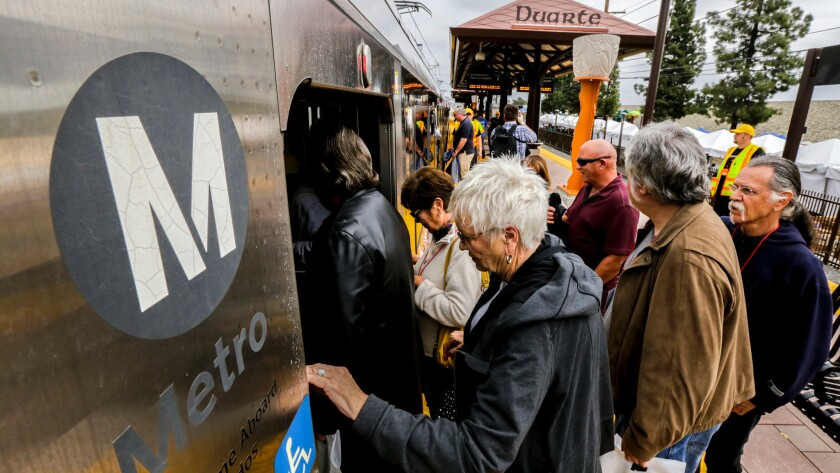 People board a Metro Gold Line train at the Duarte station on March 5, the station's first day of operation.
