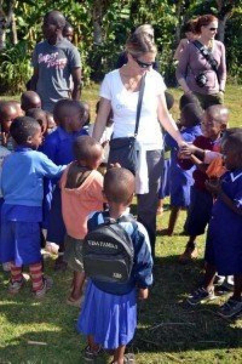 Lisa Dutton greets Tanzanian school children. Courtesy photo