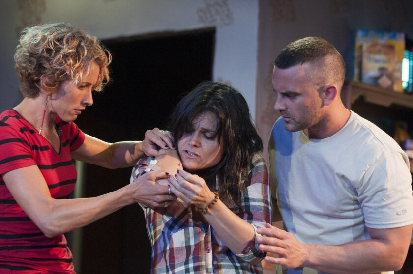 """Amanda Morrow, Hannah Logan and Steve Froehlich (left to right) in Ion Theatre's """"Bug."""""""