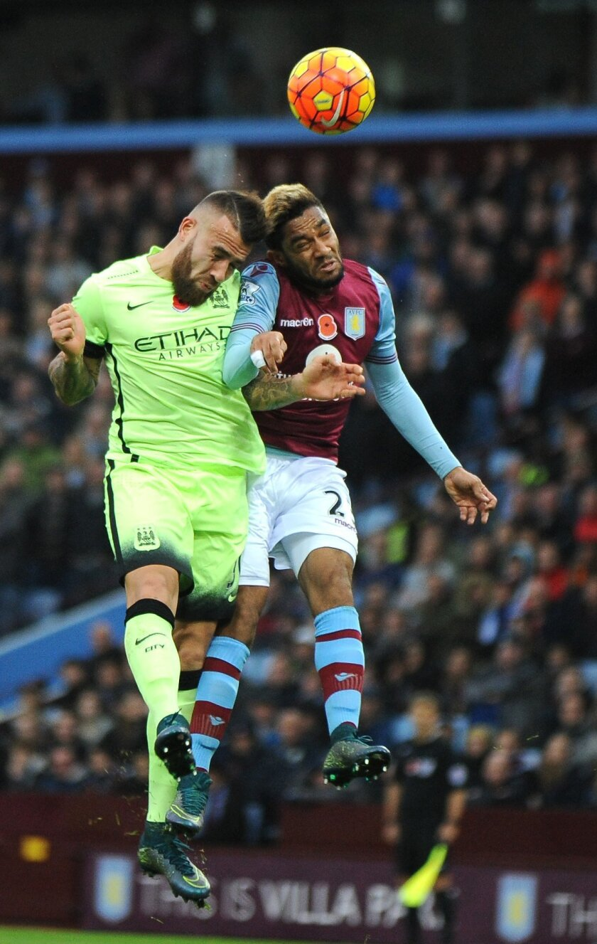 Manchester City's Nicolas Otamendi, left, and Aston Villa's Jordan Amavi jump for the ball during the English Premier League soccer match between Aston Villa and Manchester City at the Villa Park, Birmingham, England, Sunday, Nov. 8, 2015. (AP Photo/Rui Vieira)