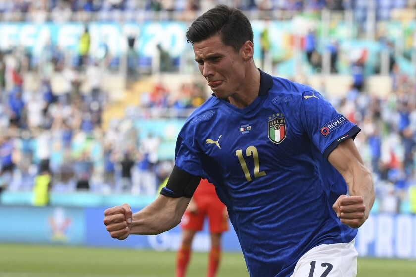 Italy's Matteo Pessina celebrates after scoring his side's opening goal during the Euro 2020 soccer championship group A match between Italy and Wales at the Stadio Olimpico stadium in Rome, Sunday, June 20, 2021. (Alberto Lingria/Pool via AP)