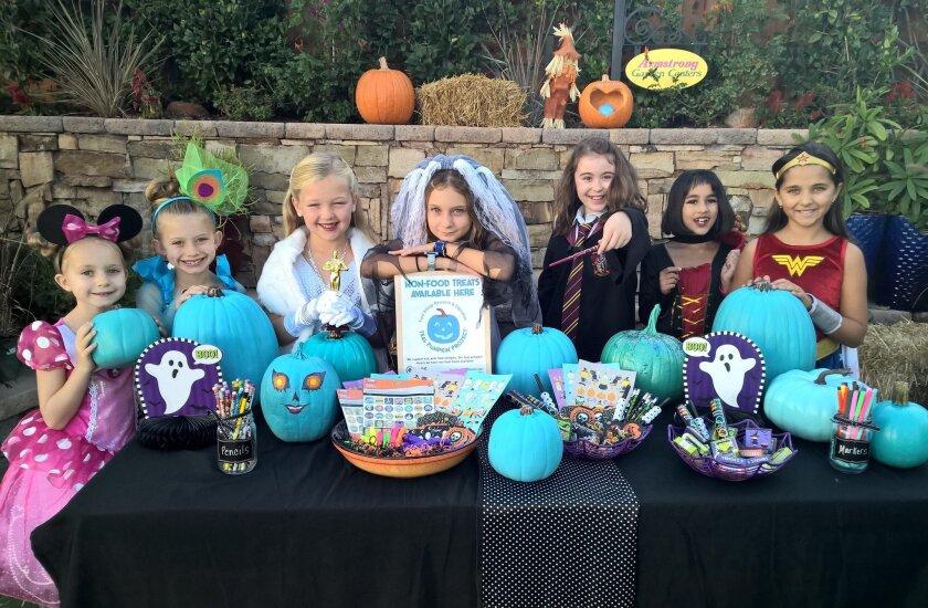 Carmel Valley's Adeline Bailey, Charlotte Bailey, Sara Fultz, Julia Krenek, Ilana Roberts, Sania Dogra, and Misha Klowas raised awareness about food allergies with the Teal Pumpkin project.