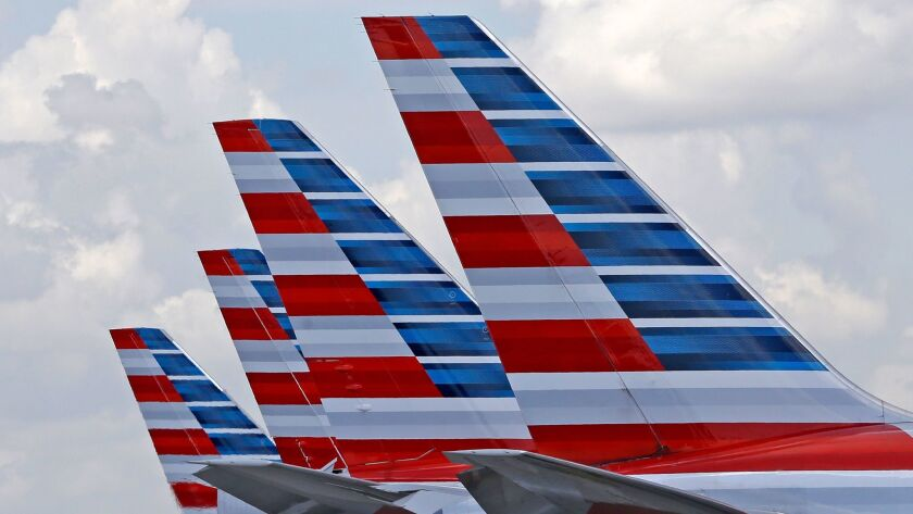 Four American Airlines passenger planes parked at Miami International Airport in 2015.