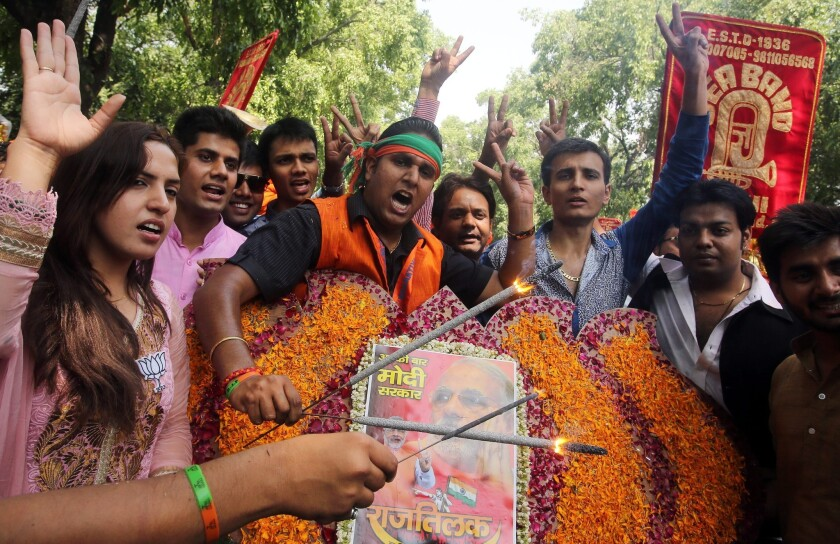 Supporters of the Bharatiya Janata Party light firecrackers as they celebrate election results outside party headquarters in New Delhi.
