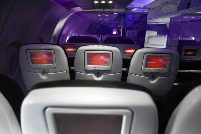 A new study by the flight-rating website Routehappy.com found that 31% of domestic flights offered wireless access as of Sept. 17. Above, in a plane operated by Virgin America, which offers wireless Internet access on all its flights, according to Routehappy.