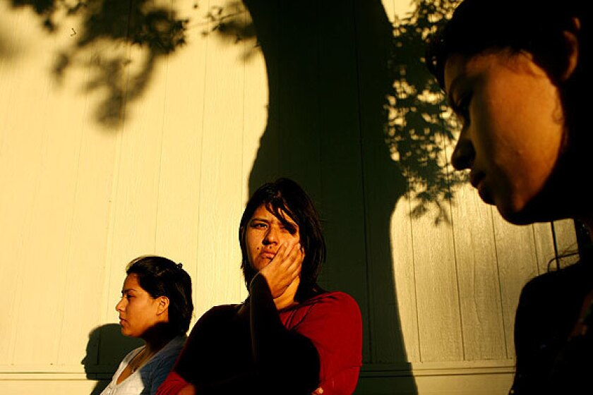 Luz Maria Diaz, 35, worries about what will happen to daughters Yolanda, 18, at left, and Diana, 16, right. The two were arrested after a fight on their school campus, then processed for possible deportation under a program known as 287(g). The program has drawn criticism after reported civil-rights violations, and the Congressional Hispanic Caucus has called for an end to it. In July, the Obama administration announced that participating agencies must focus their efforts primarily on serious and violent criminals.