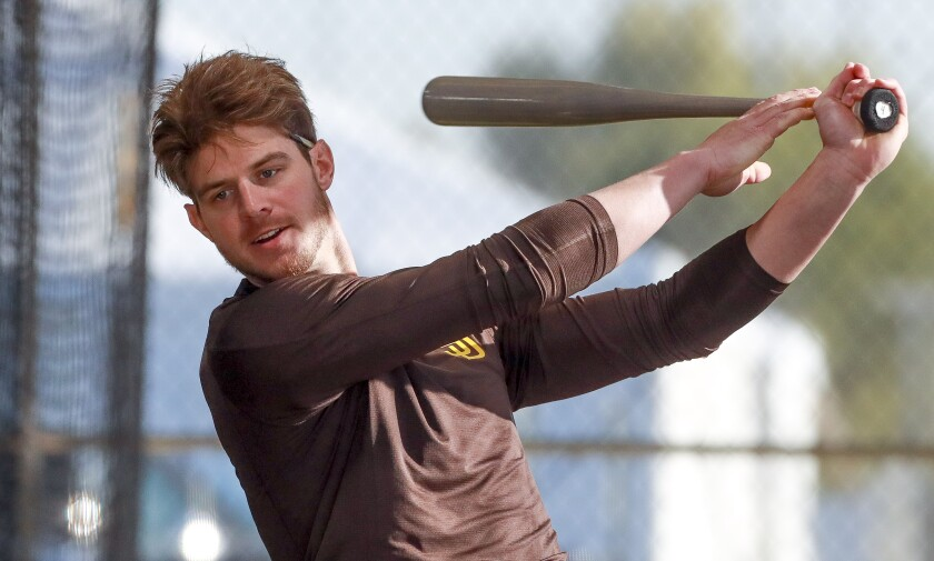 Wil Myers swings in the batting cage Saturday on his first morning at the Peoria Sports Complex.