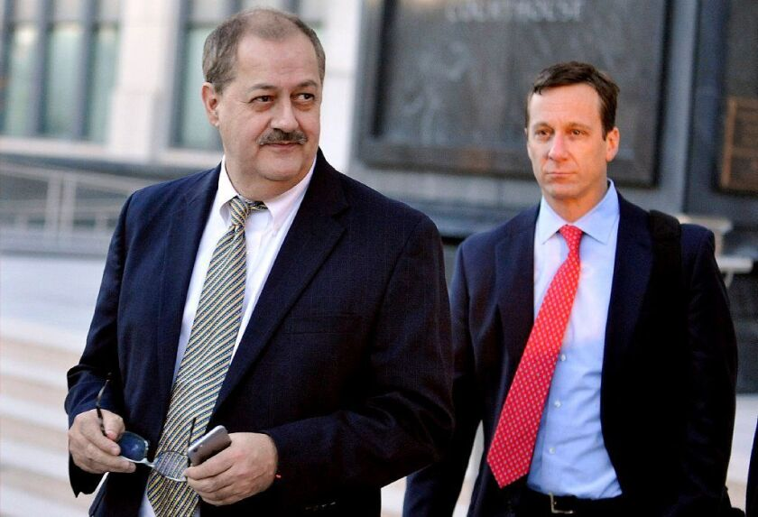 FILE - In a Tuesday, Nov. 24, 2015, file photo, former Massey Energy CEO Don Blankenship, left, walk